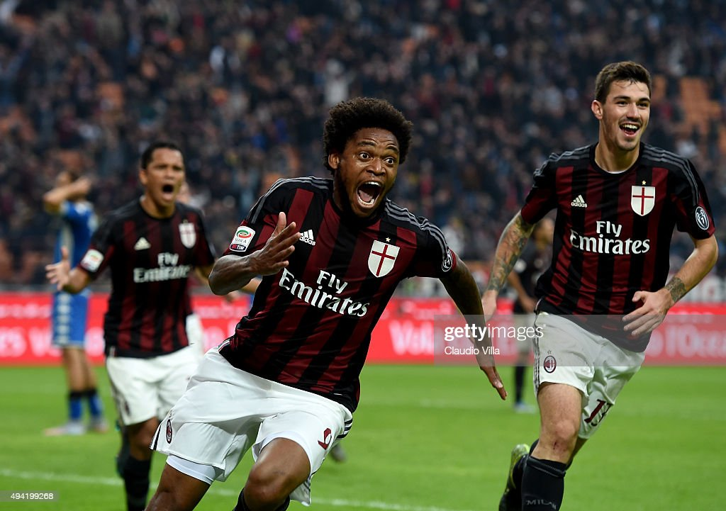 Luiz Adriano of AC Milan celebrates after scoring the second goal during the Serie A match between AC Milan and US Sassuolo Calcio at Stadio Giuseppe Meazza on October 25, 2015 in Milan, Italy.