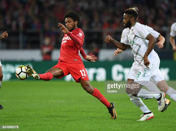 Luiz Adriano of FC Spartak Moscow vies for the ball with Alex Song of FC Rubin Kazan during the Russian Premier League match between FC Spartak...