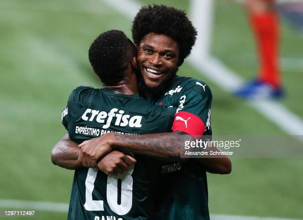 Luiz Adriano of Palmeiras celebrates with his team mate after scoring the fourth goal of their team during the match against Corinthians as part of...