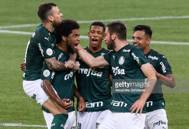 Luiz Adriano of Palmeiras celebrates with his team mates after scoring the first goal of their team during the match against Red Bull Bragantino as...