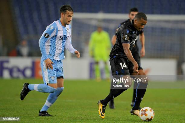 Luiz Alessandro Murgia of SS Lazio compete for the ball with Alassane Plea of OGC Nice during the UEFA Europa League group K match between Lazio Roma...