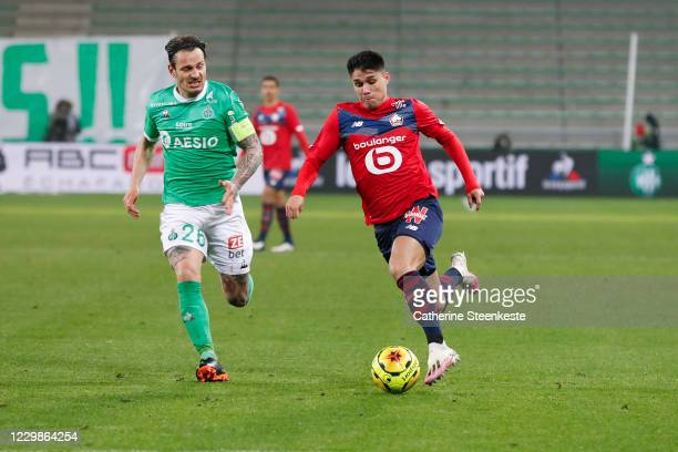 Luiz Araujo of Lille OSC controls the ball against Mathieu Debuchy of AS Saint-Etienne during the Ligue 1 match between AS Saint-Etienne and Lille...