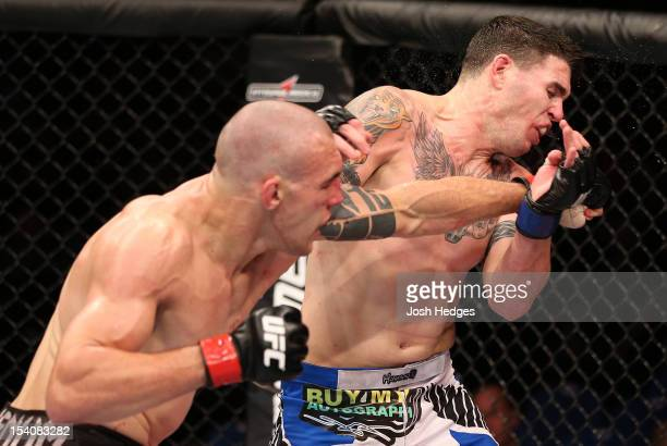 Luiz Cane punches Chris Camozzi during their middleweight fight at UFC 153 inside HSBC Arena on October 13 2012 in Rio de Janeiro Brazil
