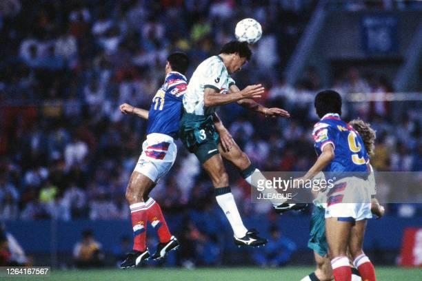 Luiz Carlos Pereira of Verdy Kawasaki and David Bisconti of Yokohama Marinos compete for the ball during the JLeague Suntory Series match between...