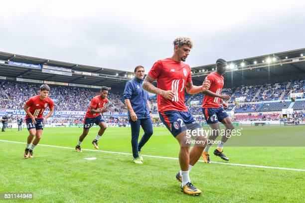Luiz De Araujo and THiago Mendes Ribeiro of Lille and Kevin Malcuit and Fode Ballo of Lille during the Ligue 1 match between Racing Club Strasbourg...