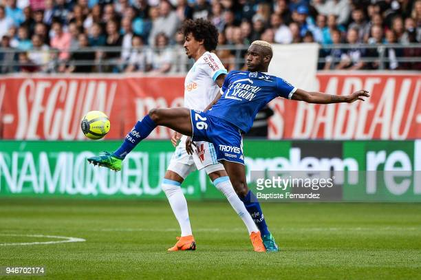 Luiz Dias of Marseille and Adama Niane of Troyes during the Ligue 1 match between Troyes Estac and Olympique de Marseille at Stade de l'Aube on April...