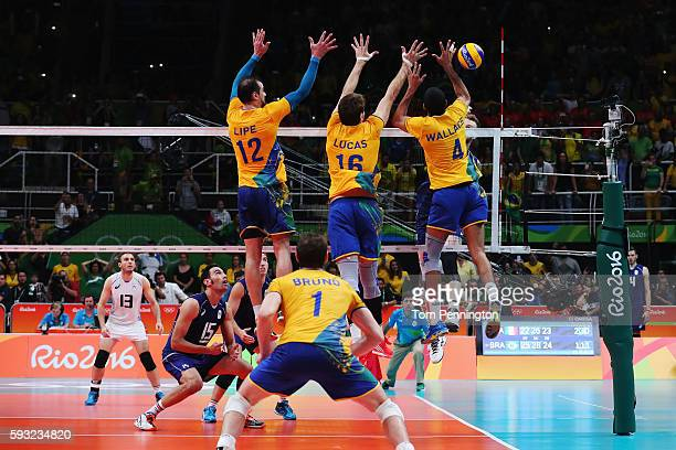 Luiz Felipe Marques Fonteles of Brazil Lucas Saatkamp of Brazil and Wallace de Souza of Brazil block during the Men's Gold Medal Match between Italy...