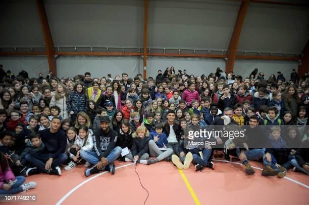Luiz felipe Ramos Marchi Fortuna Wallace Joaquin Correa and Danilo Cataldi of SS Lazio pose a photo with the children during the SS Lazio players...