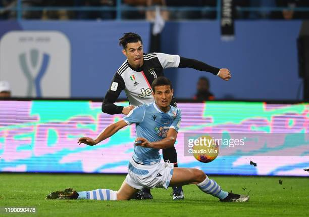 Luiz Felipe Ramos Marchi of SS Lazio competes for the ball against Cristiano Ronaldo of Juventus during the Italian Supercup match between Juventus...