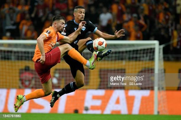 Luiz Felipe Ramos Marchi of SS Lazio competes for the ball with Berkan Kutlu of Galatasaray during the UEFA Europa League group E match between...