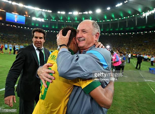 Luiz Felipe Scolari head coach of Brazil embraces Neymar of Brazil at the end of the FIFA Confederations Cup Brazil 2013 Final match between Brazil...