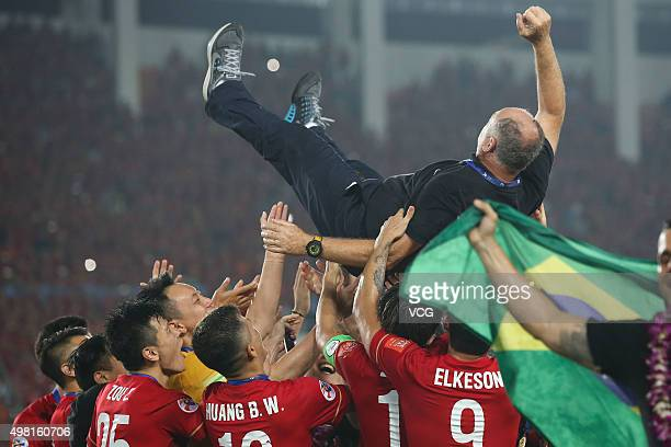 Luiz Felipe Scolari, head coach of Guangzhou Evergrande, is thrown in the air by his players as they celebrate after winning the second leg of the...