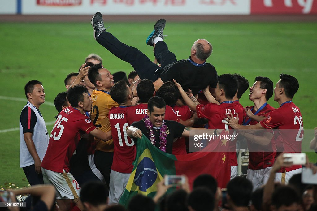 Luiz Felipe Scolari, head coach of Guangzhou Evergrande, is thrown in the air by his players as they celebrate after winning the second leg of the AFC Champions League final match between Guangzhou Evergrande and Al Ahli at the Tianhe Sports Center on November 21, 2015 in Guangzhou, China.