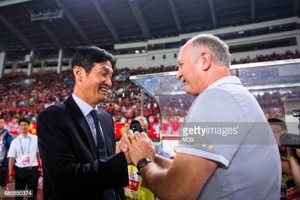 Luiz Felipe Scolari head coach of Guangzhou Evergrande shakes hands with Choi Yongsoo head coacha of Jiangsu Suning prior to the 10th round match of...