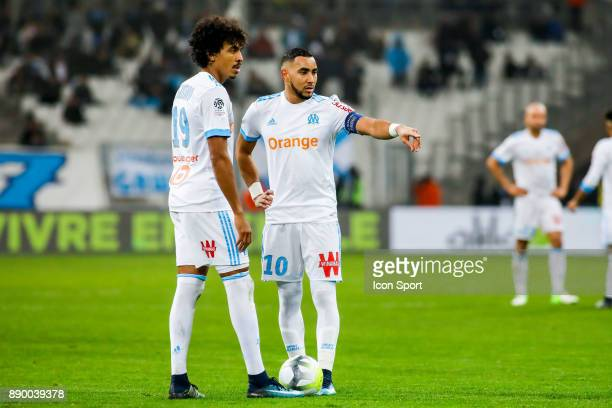 Luiz Gustavo and Dimitri Payet of Marseille during the Ligue 1 match between Olympique Marseille and AS SaintEtienne at Stade Velodrome on December...