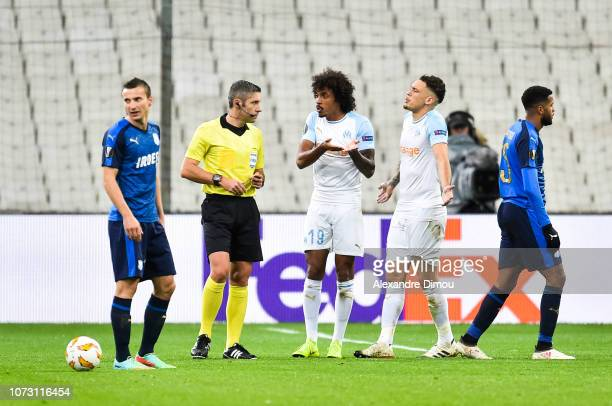 Luiz Gustavo and Lucas Ocampos of Marseille and Radu Petrescu referee during the Europa League match between Olympique Marseille and Apollon Limassol...