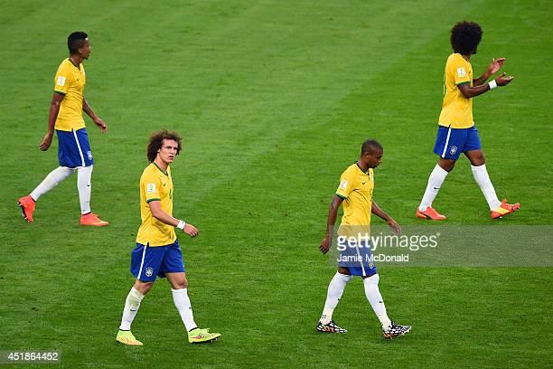Luiz Gustavo, David Luiz, Fernandinho and Dante of Brazil look dejected after a goal during the 2014 FIFA World Cup Brazil Semi Final match between...