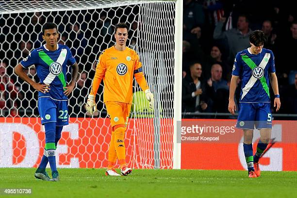 Luiz Gustavo Diego Benaglio and Timm Klose of Wolfsburg look dejected after the second goal of Eindhoven during the UEFA Champions League Group B...