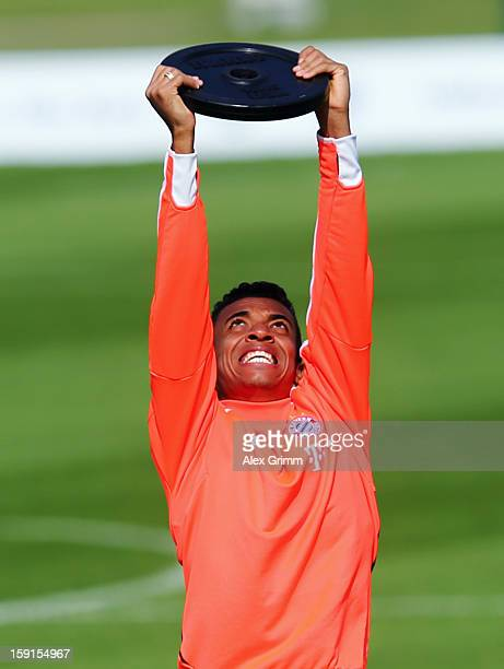 Luiz Gustavo exercises during a Bayern Muenchen training session at the ASPIRE Academy for Sports Excellence on January 9 2013 in Doha Qatar