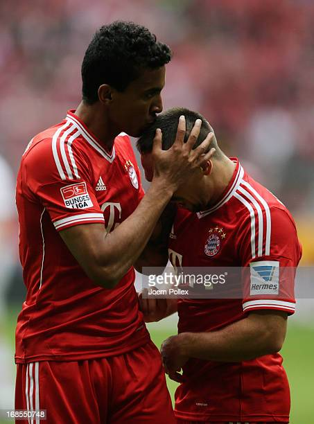 Luiz Gustavo of Bayern Muenchen celebrates with Franck Ribery as he scores their third goal during the Bundesliga match between FC Bayern Muenchen...