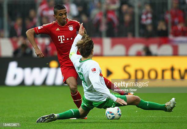 Luiz Gustavo of Bayern Muenchen fights for the ball with Clemens Fritz of Werder Bremen during the Bundesliga match between FC Bayern Muenchen and SV...