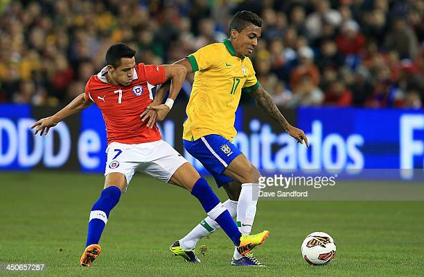 Luiz Gustavo of Brazil battles for the ball with Alexis Sanchez of Chile during a friendly match at Rogers Centre on November 19 2013 in Toronto...