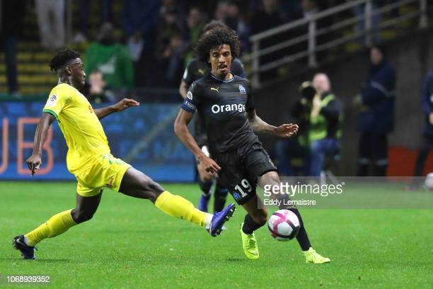 Luiz Gustavo of Marseille and Enock Kwateng of Nantes during the French Ligue 1 match between FC Nantes and Olympique de Marseille on December 5 2018...