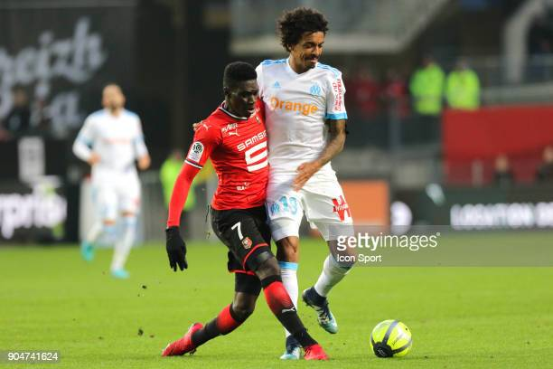 Luiz Gustavo of Marseille and Ismaila Sarr of Rennes during the Ligue 1 match between Rennes and Marseille at Roazhon Park on January 13 2018 in...