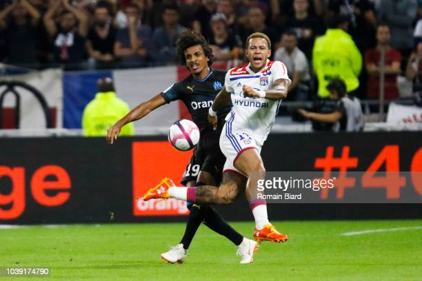 Luiz Gustavo of Marseille and Memphis Depay of Lyon during the Ligue 1 match between Lyon and Marseille at Parc Olympique on September 23 2018 in...