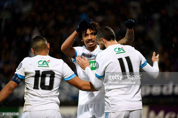 Luiz Gustavo of Marseille celebrates with Konstantinos Kostas Mitroglou and Dimitri Payet during the French National Cup match between Bourg en...