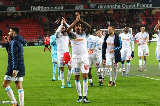 Luiz Gustavo of Marseille celebrates with supporters at the end of the match during the Ligue 1 match between Rennes and Marseille at Roazhon Park on...