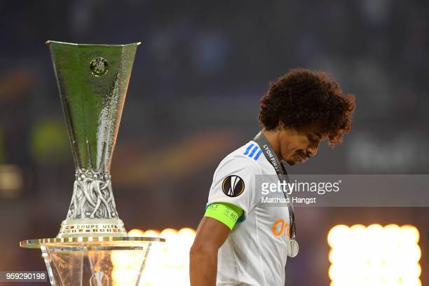 Luiz Gustavo of Marseille walks past the trophy after collecting his runners up medal following the UEFA Europa League Final between Olympique de...