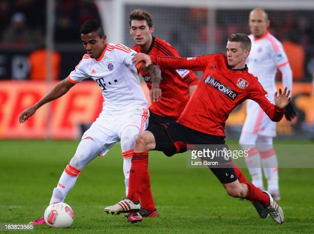 Luiz Gustavo of Muenchen is challenged by Lars Bender of Leverkusen during the Bundesliga match between Bayer 04 Leverkusen and FC Bayern Muenchen at...