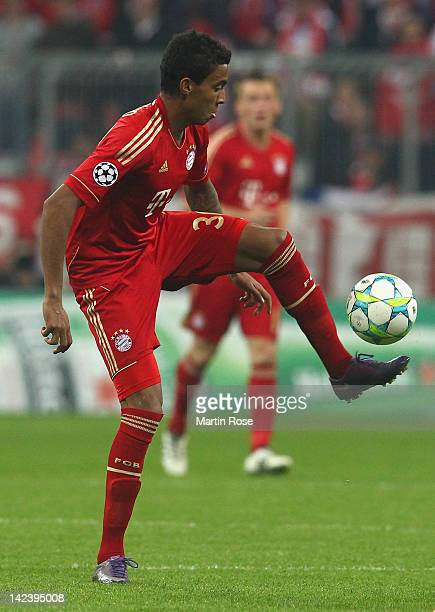 Luiz Gustavo of Muenchen runs with the ball during the UEFA Champions League quarterfinal second leg match at Allianz Arena on April 3 2012 in Munich...