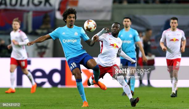 Luiz Gustavo of Olympique Marseille vies with Naby Keita of RB Leipzig during the UEFA Europa League quarter final leg one match between RB Leipzig...