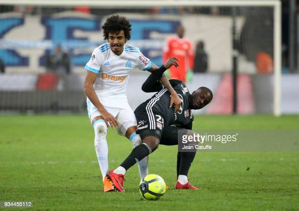 Luiz Gustavo of OM Tanguy Ndombele of Lyon during the French Ligue 1 match between Olympique de Marseille OM and Olympique Lyonnais OL at Stade...