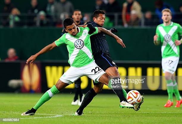 Luiz Gustavo of VfL Wolfsburg and Fredy Guarin of Milano battle for the ball during the UEFA Europa League Round of 16 first leg match between VfL...