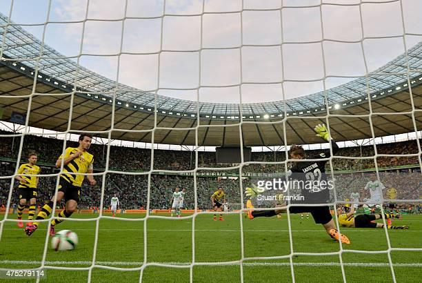 Luiz Gustavo of VfL Wolfsburg scores his teams first goal during the DFB Cup Final match between Borussia Dortmund and VfL Wolfsburg at...