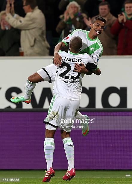 Luiz Gustavo of Wolfsburg celebrates scoring his team's second goal with Naldo of Wolfsburg during the Bundesliga match between VfL Wolfsburg and...