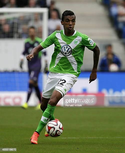 Luiz Gustavo of Wolfsburg runs with the ball during the Bundesliga match between 1899 Hoffenheim and VfL Wolfsburg at Wirsol RheinNeckarArena on...