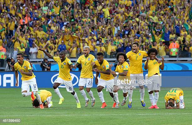 Luiz Gustavo Ramires Dani Alves Jo Marcelo Hulk Willian and Neymar of Brazil celebrate the victory after the penalty shootout of the 2014 FIFA World...