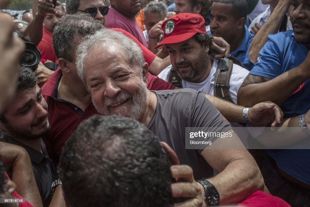 Luiz Inacio Lula da Silva, former president of Brazil, greets supporters during a presidential pre-campaign rally outside the Petroleo Brasileiro SA (Petrobras) Petrochemical Complex in Itaborai, Brazil, on Thursday, Dec. 7, 2017. Brazil's 2018 presidential race is shaping up to be an inflection point in the nation's three-decade-old democracy. While markets are hoping for a centrist, reformist candidate, polls show Lula leading despite a conviction on corruption charges that may bar him from running. Photographer: Dado Galdieri/Bloomberg via Getty Images