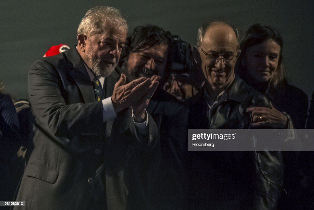 Luiz Inacio Lula da Silva, former president of Brazil, left, gestures to supporters after testifying before Sergio Moro, the lead jurist in the sprawling corruption probe known as Operation Carwash, in Curitiba, Brazil, on Wednesday, May 10, 2017. Thousands of Brazilians are descending on the southern city of Curitiba before a showdown between one of the most popular leaders in the country's history and its most famous judge at a hearing that could determine the republic's future. Photographer: Dado Galdieri/Bloomberg via Getty Images
