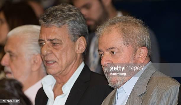 Luiz Inacio Lula da Silva former president of Brazil right and Chico Buarque singer listen during the impeachment trial of Dilma Rousseff suspended...