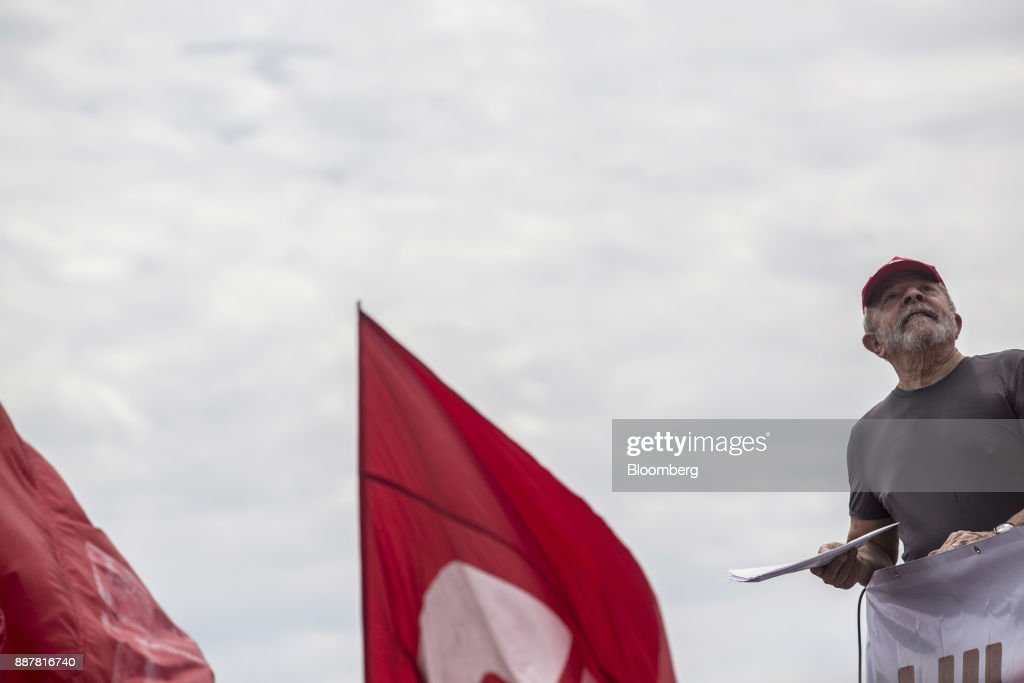 Luiz Inacio Lula da Silva, former president of Brazil, speaks during a presidential pre-campaign rally outside the Petroleo Brasileiro SA (Petrobras) Petrochemical Complex in Itaborai, Brazil, on Thursday, Dec. 7, 2017. Brazil's 2018 presidential race is shaping up to be an inflection point in the nation's three-decade-old democracy. While markets are hoping for a centrist, reformist candidate, polls show Lula leading despite a conviction on corruption charges that may bar him from running. Photographer: Dado Galdieri/Bloomberg via Getty Images