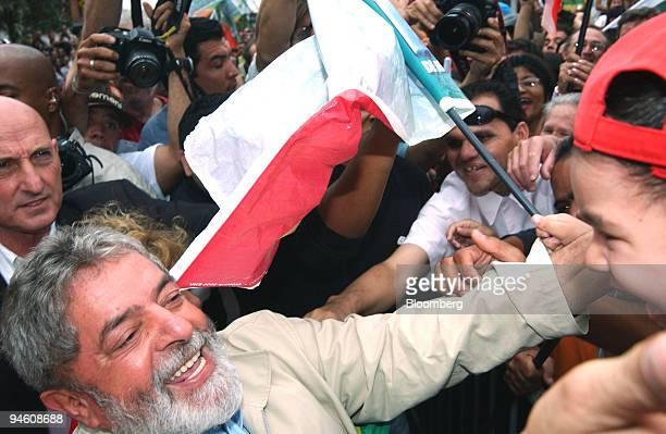 Luiz Inacio Lula da Silva president of Brazil reaches for child at a polling place in So Bernado do Campo near Sao Paulo Brazil October 29 2006...