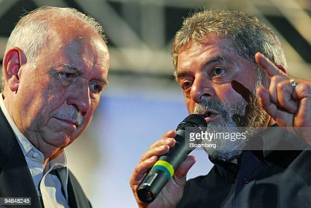 Luiz Inacio Lula da Silva, president of Brazil, right, and Jose Alencar, vice president, speak at a rally in Sao Bernardo do Campo, Brazil, Thursday,...