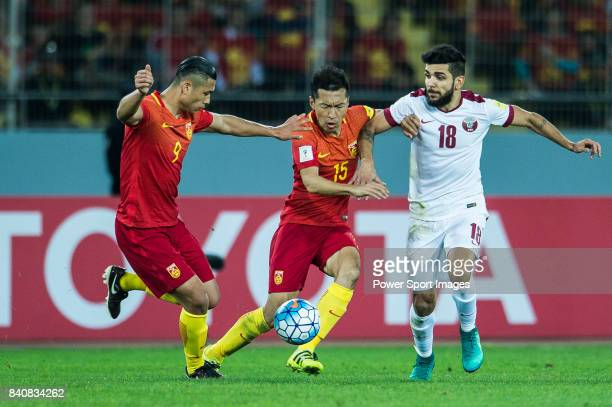 Luiz Junior of Qatar fights for the ball with Zhang Yuning and Wu Xi of China PR during the 2018 FIFA World Cup Russia Asian Qualifiers Final...