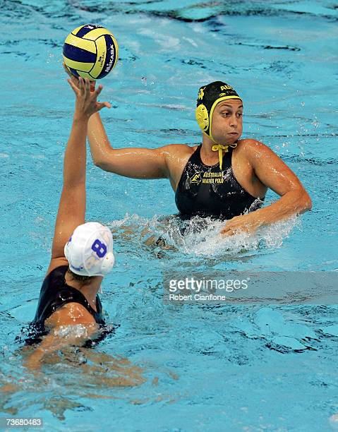 Luiza Carvalho of Brazil attempts to block the pass from Rebecca Rippon of Australia during the Women's Preliminary Round Group B Water Polo match...