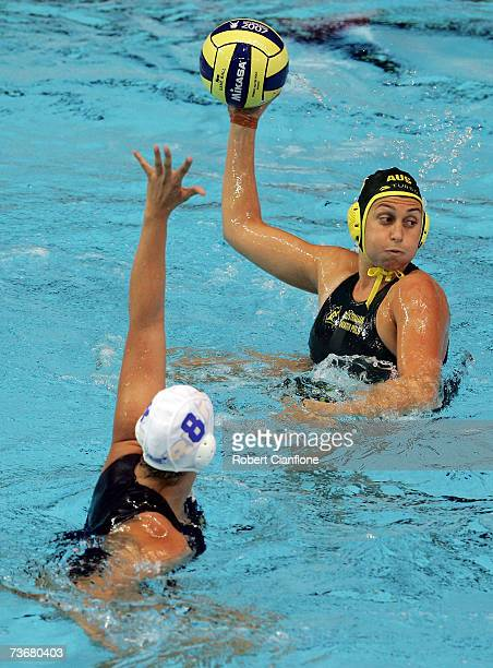 Luiza Carvalho of Brazil attempts to block the pass from Rebecca Ripponof Australia during the Women's Preliminary Round Group B Water Polo match...